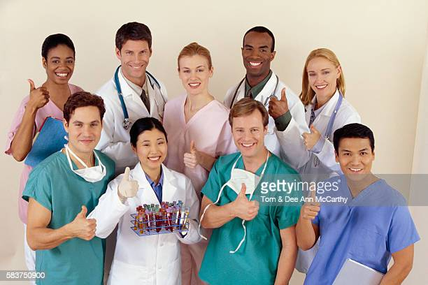medical team giving thumbs up - dr dee stock pictures, royalty-free photos & images