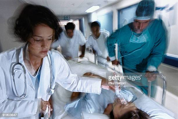 medical team helping patient in emergency - hospital ventilator stock pictures, royalty-free photos & images
