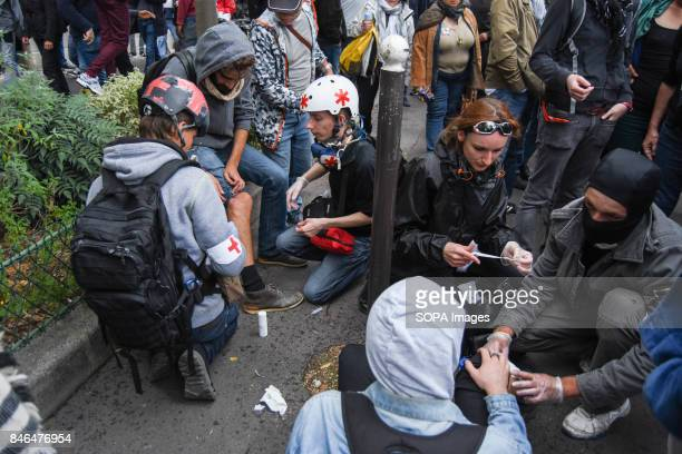 A medical team helps an injured protester during the nationwide strike called by various French unions against proposed labour law reforms by the...