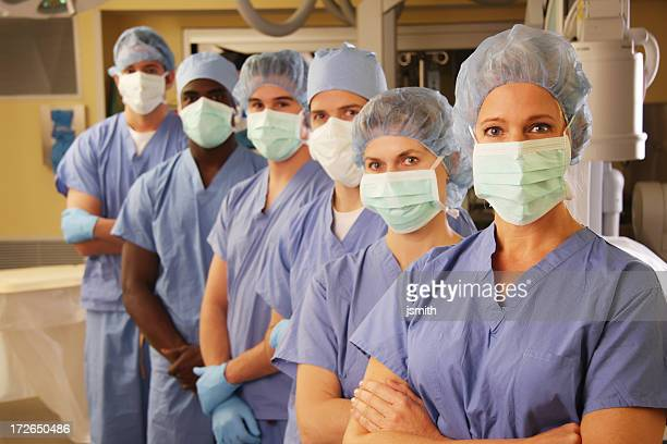 medical team in operating room 2 - nursing assistant stock pictures, royalty-free photos & images