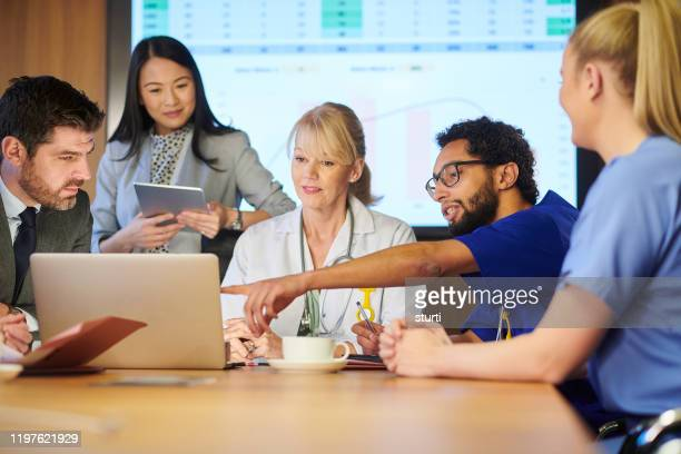 medical team meeting - marketing stock pictures, royalty-free photos & images
