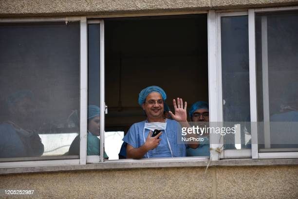 Medical Team members and Doctors wave from window after successful second time Kidney transplant of Prime Minister KP Sharma Oli at Tribhuwan...