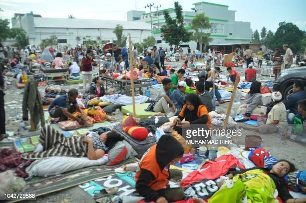 TOPSHOT Medical team members help patients outside a hospital after an earthquake and a tsunami hit Palu on Sulawesi island on September 29 2018...