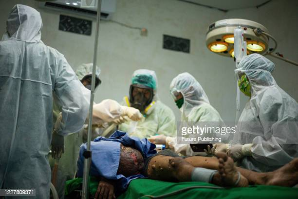Medical team prepare for surgery Andriadi Putra at Accu Plast Hospital in Medan North Sumatra A MAN who was living with 30 kilograms of tumours...