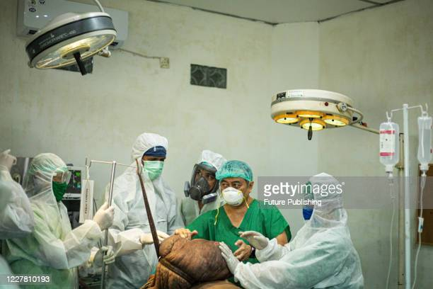 Medical team prepare for surgery Andriadi Putra at Accu Plast Hospital, in Medan, North Sumatra. A MAN who was living with 30 kilograms of tumours...