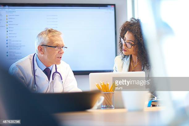 medical team presentation - administrator stock pictures, royalty-free photos & images
