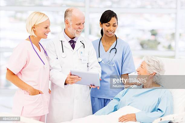 Medical Team Showing Reports To Patient In Hospital