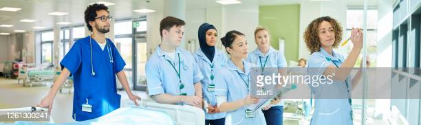 medical team training centre - panoramic stock pictures, royalty-free photos & images