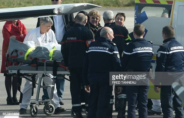 TOPSHOT A medical team transfer into an ambulance a student of the SaintJoseph secondary school in Concarneau one of three from the school who were...