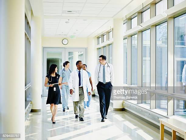 Medical team walking through hospital corridor