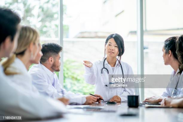medical team works together to learn and research. - medical student stock pictures, royalty-free photos & images