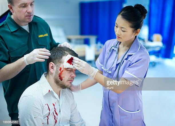 medical teamwork - head injury stock photos and pictures