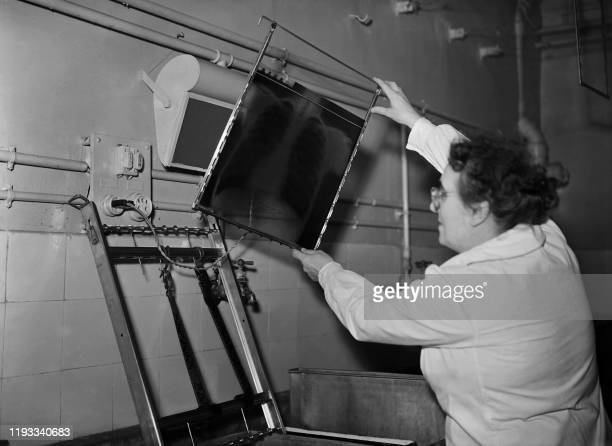 A medical technician checks an xray radiography of the lungs during a tuberculosis screening operation at a screening center rue d'Assas in Paris in...