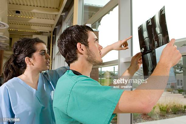 Medical Technicians Reviewing X-rays
