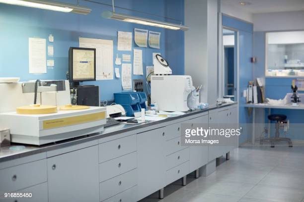 medical test machine on counter in animal hospital - place of research stock pictures, royalty-free photos & images