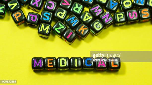 Medical Text With Colorful Alphabet Blocks On Yellow Background