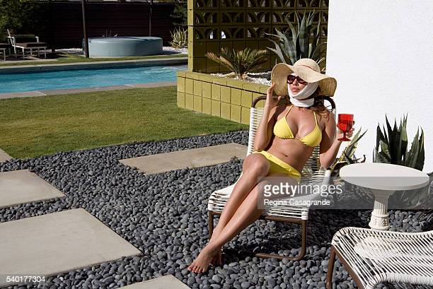 Medical Tourist Recovering from Plastic Surgery by Swimming Pool