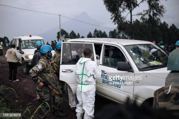 Medical vehicle of the North Kivu hospital is loaded with the body of the driver on a road on the edge of the Virunga National Park near the village...
