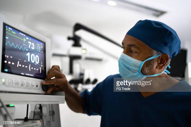 medical ventilator being monitored by anaesthetist - anesthetic stock pictures, royalty-free photos & images