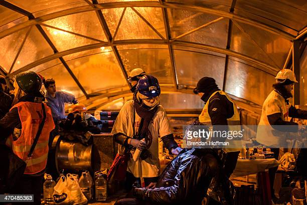 Medical volunteers treat an injured antigovernment protester in a makeshift clinic near Independence Square on February 19 2014 in Kiev Ukraine After...