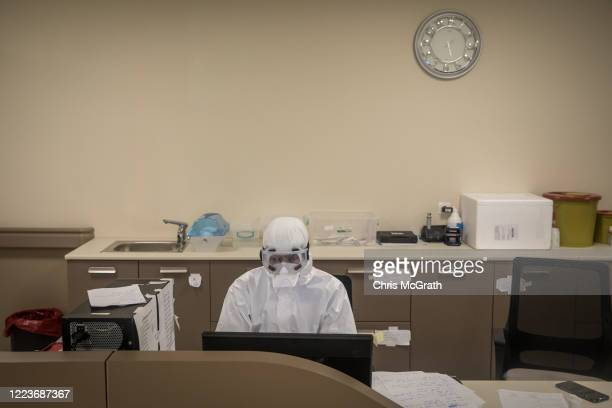 Medical worker dressed in personal protective equipment works at a computer inside the COVID-19 ICU at the Kartal Dr. Lutii Kirdar Education and...