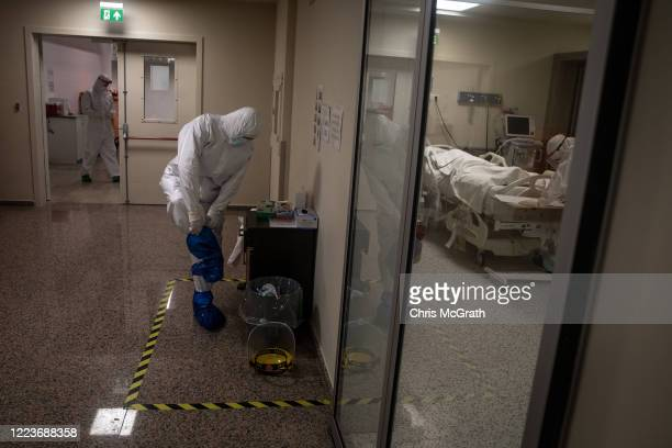 Medical worker gets dressed in personal protective equipment before assisting COVID-19 patients in the Kartal Dr. Lutii Kirdar Education and Research...