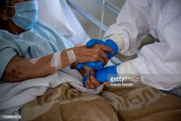 A medical worker greets a patient suffering from COVID19 in an intensive care unit in the Covid department of Rome's San Filippo Neri Hospital on...