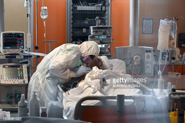 TOPSHOT A medical worker in protective gear tends to a patient on March 24 2020 at the new COVID 3 level intensive care unit for coronavirus COVID19...