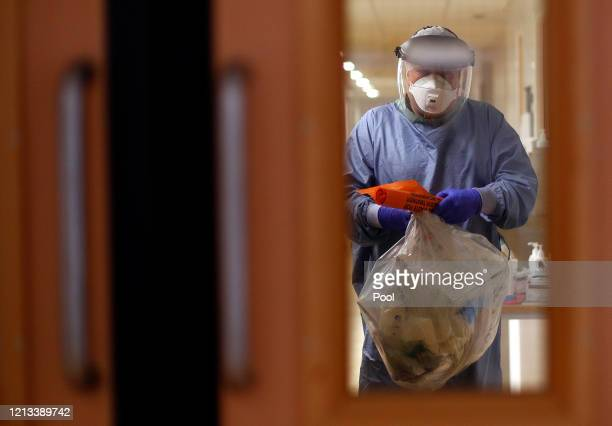 Medical worker is seen through the door to the Critical Care Unit at The Royal Blackburn Teaching Hospital in East Lancashire, during the current...