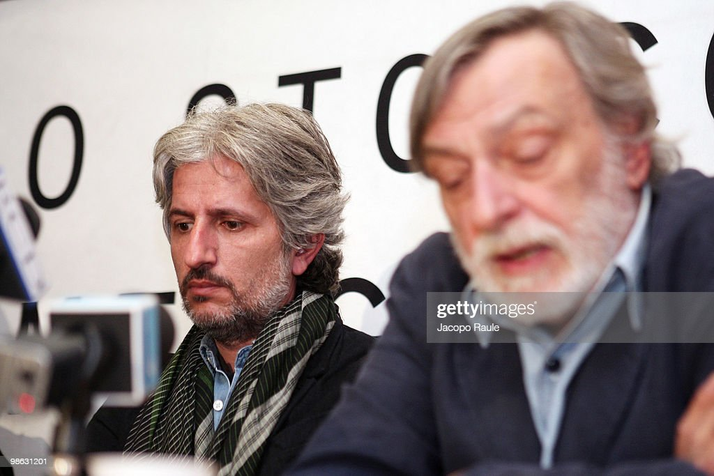 Medical worker Matteo Dell'Aira (L) attends a press conference with Gino Strada, founder of Italian aid agency Emergency, at the agency's headquarters on April 23, 2010 in Milan, Italy. Matteo Dell'Aira, Marco Garatti and Matteo Pagani, all employees of Emergency, were released after being held for a week by Afghan authorities over an alleged assassination plot against the governor of Helmand province.