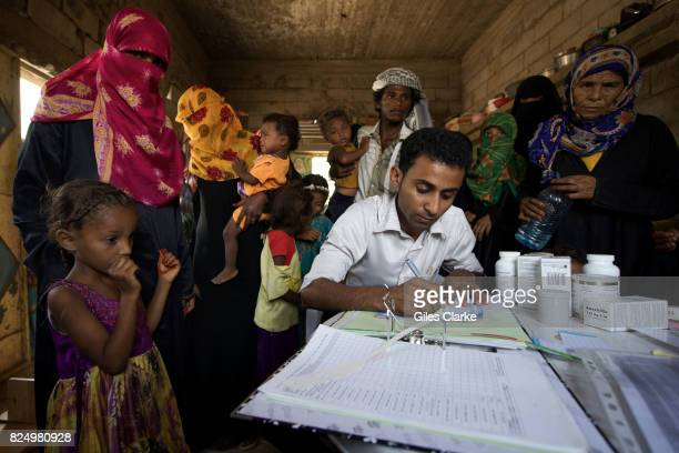 A medical worker registers young patients in the small rural village of AnNassiri located about 60 km from Al Hudaydah Only 45 per cent of health...
