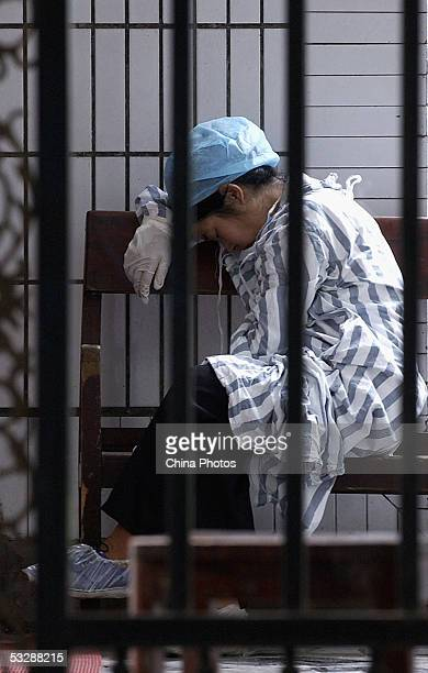 Medical worker rests outside of the infection department at the Ziyang First People's Hospital, where patients suffering from a mysterious disease...