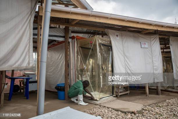 A medical worker secures an isolation unit in the Ebola treatment centre in Beni eastern Democratic Republic of the Congo The DRC is currently...