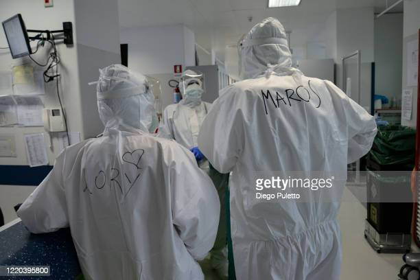 Medical worker talk with each other in an intensive care unit in the Covid department of Turin San Luigi Hospital on April 22 in Turin, Italy. The...