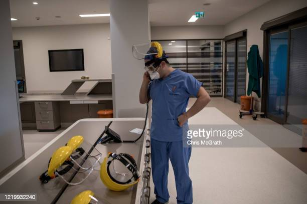 A medical worker talks on the phone inside the COVID19 dedicated ICU at the Acibadem Altunizade Hospital on April 16 2020 in Istanbul Turkey Since...