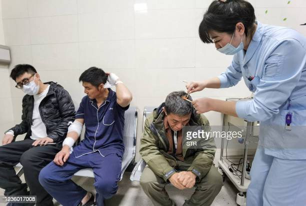 Medical worker tends to a patient at a hospital in Shenyang, China's northeastern Liaoning province on October 21 after a gas explosion at a...