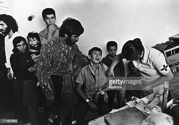 A medical worker tends to a young victim of the Civil War in Lebanon 1976