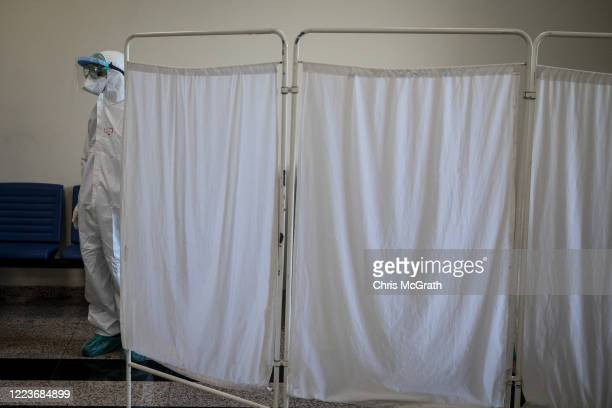Medical worker waits for patients to arrive for COVID-19 tests at the Kartal Dr. Lutii Kirdar Education and Research Hospital on May 08, 2020 in...