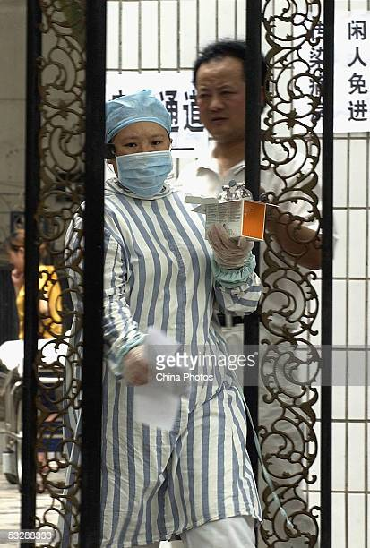 Medical worker walks out of the infection department at the Ziyang First People's Hospital, where patients suffering from a mysterious disease are...