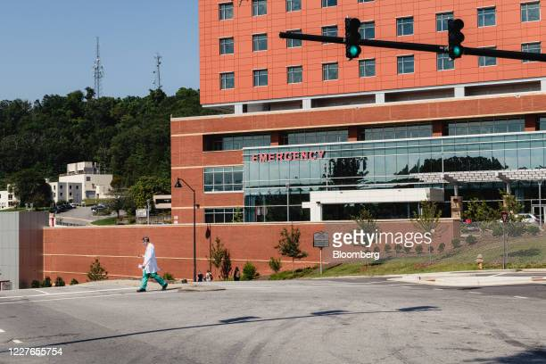 A medical worker walks outside Mission Hospital in Asheville North Carolina US on Wednesday July 15 2020 At least 93426 people in North Carolina have...
