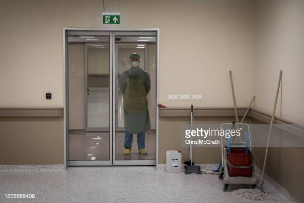 Medical worker watches on from outside a COVID-19 ICU unit at the Kartal Dr. Lutii Kirdar Education and Research Hospital, Intensive Care Unit on May...