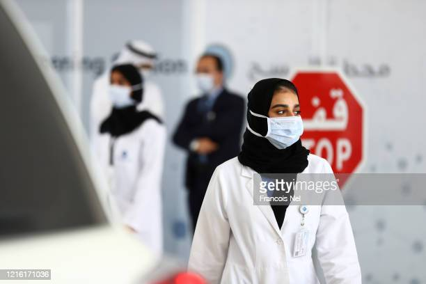 A medical worker wearing a protective face mask is seen on April 01 2020 in Abu Dhabi United Arab Emirates The Coronavirus pandemic has spread to...