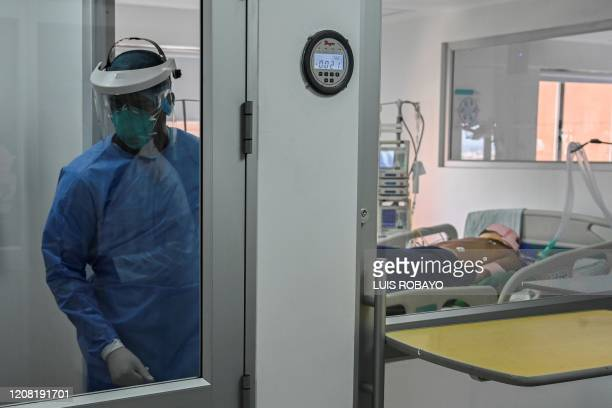 A medical worker wearing protective gear attends a suspected COVID19 patient in the intensive care unit of the 'Clinica Nueva de Cali' clinic in Cali...