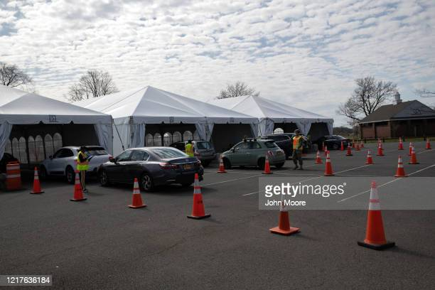Medical workers and National Guardsmen receive possible COVID-19 patients at a drive-thru testing center on April 07, 2020 in New Rochelle, New York....