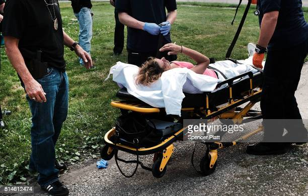 Medical workers and police treat a woman who has overdosed on heroin the second case in a matter of minutes on July 14 2017 in Warren Ohio According...