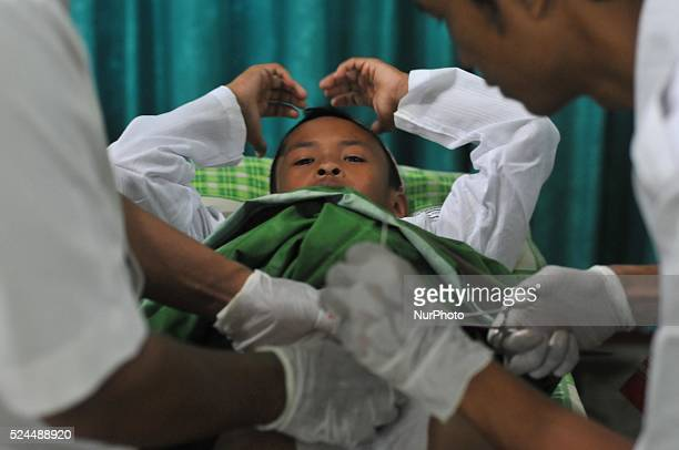 Medical workers circumcise Muslim boy in the annual mass circumcision in Karanganyar Central Java Indonesia on November 27 2014 The mass circumcision...