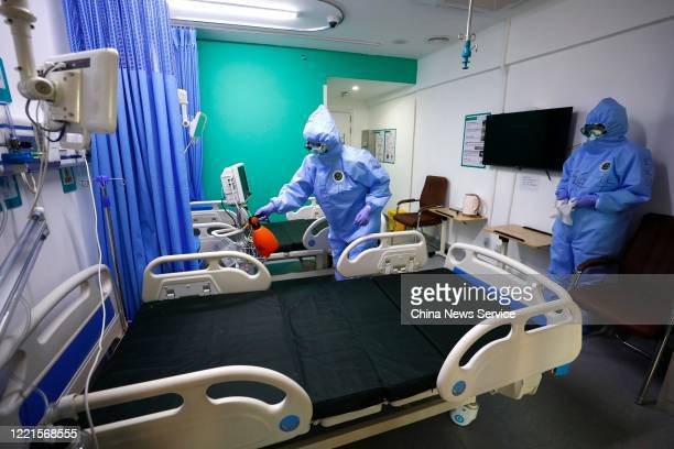 Medical workers disinfect a ward after the last two COVID19 patients are discharged from Xiaotangshan Hospital on April 28 2020 in Beijing China All...