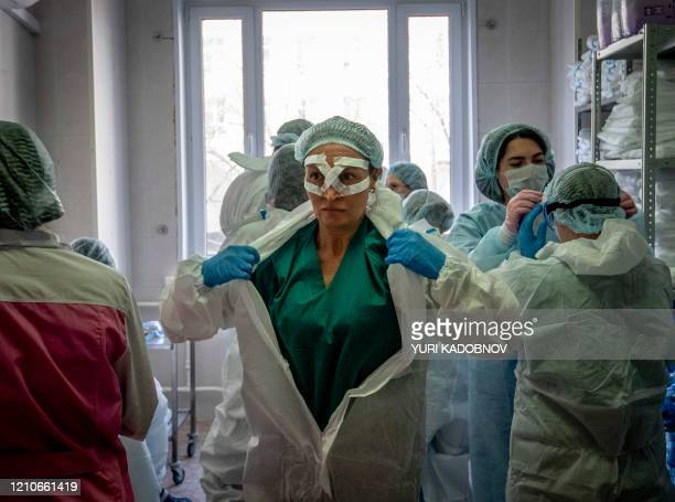 Medical workers get ready for a shift treating coronavirus patients at the Spasokukotsky clinical hospital in Moscow on April 22, 2020.