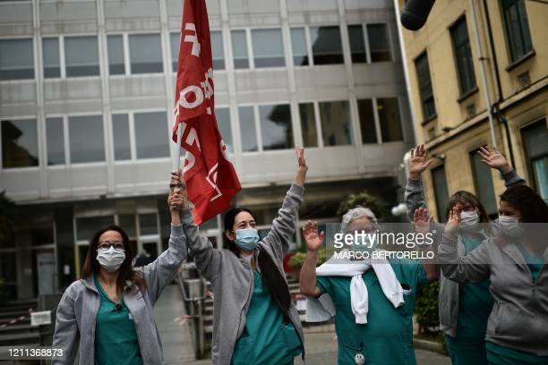 Medical workers hold a protest organized by CGIL and UIL trade unions outside the Molinette hospital in Turin on April 30 against dysfunctions in the...