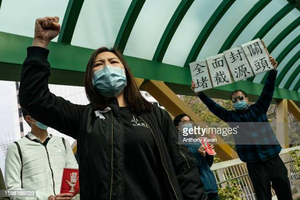 Medical workers hold a strike near Queen Mary Hospital to demand the government shut the city's border with China to reduce the spread of the...